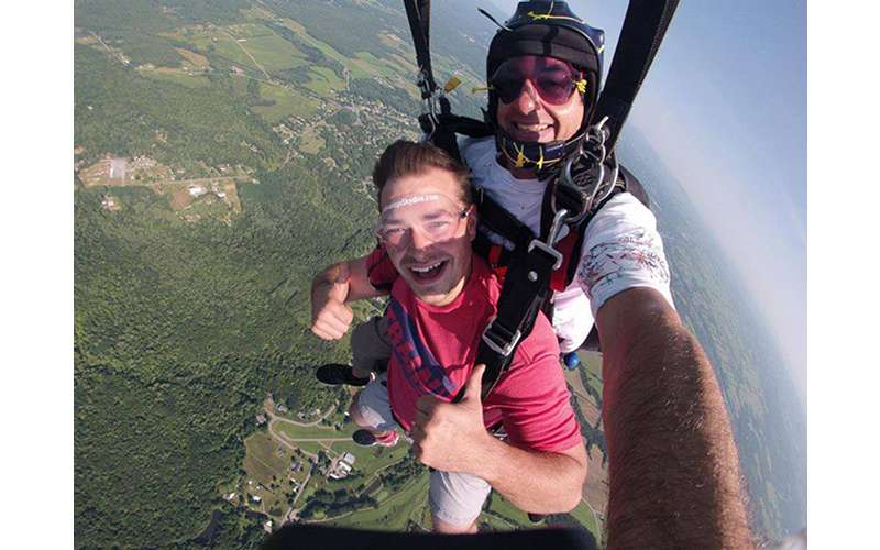 Man doing a tandem jump with a guide