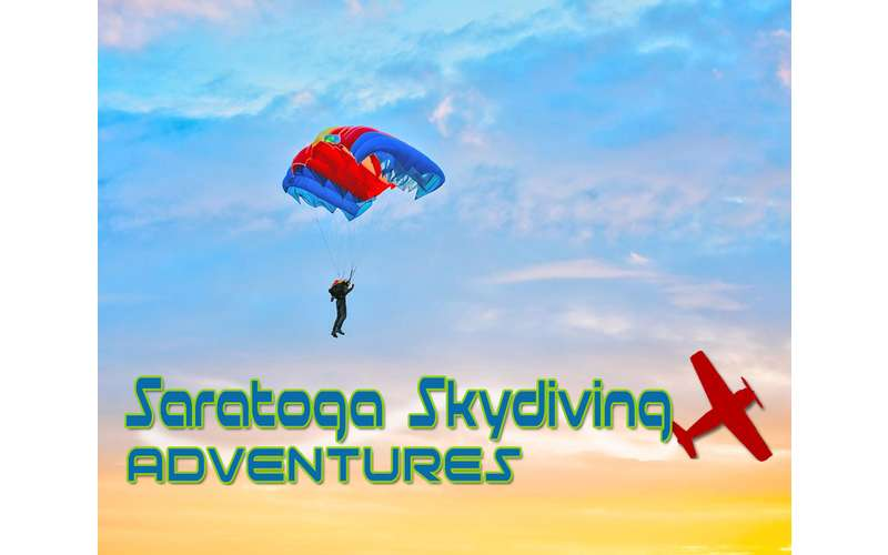 Person in the sky with a parachute and the words &quote;Saratoga Skydiving Adventures
