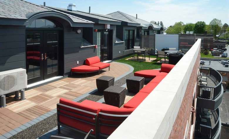 rooftop deck at the pavilion grand hotel featuring red couches
