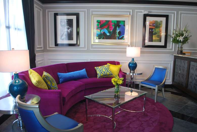pavilion grand hotel lobby featuring a large purple couch and two bright blue chairs
