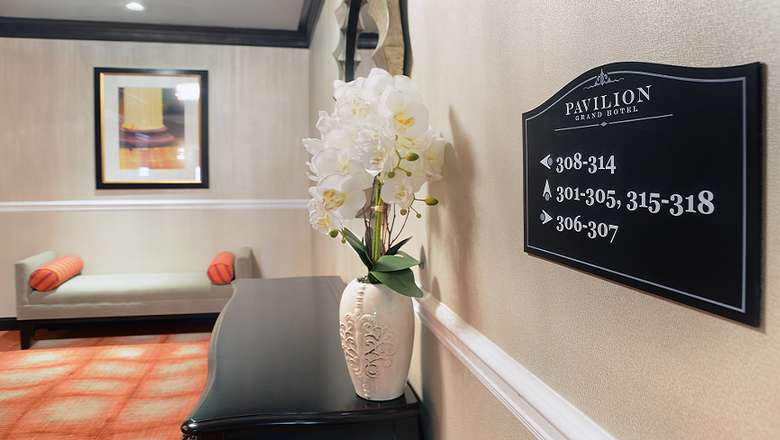 sign that shows where certain rooms are at the pavilion grand hotel