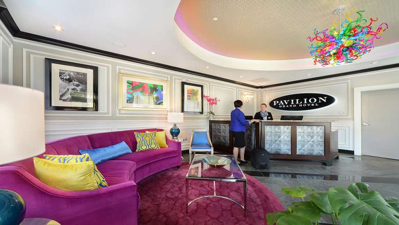 lobby of the pavilion grand hotel with a purple couch