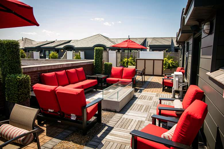 Bright red chairs on rooftop patio
