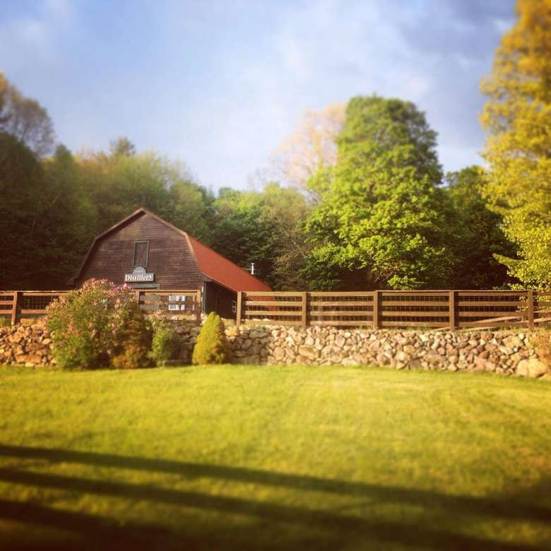springbrook hollow farm distillery's green lawn and lush property