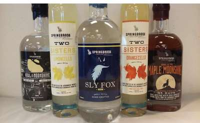 five bottles of various handcrafted spirits by Springbrook Hollow Farm Distillery