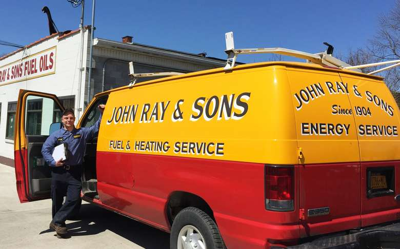 a red and yellow van with the words john ray and sons fuel and heating service
