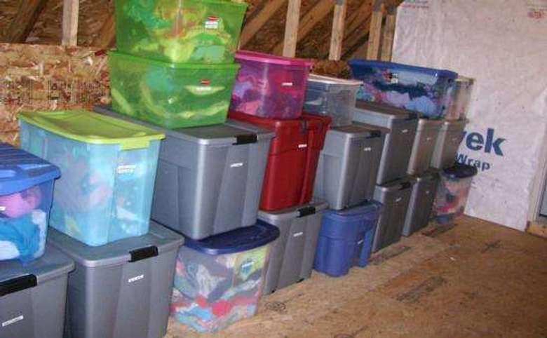 organized attic storage area with lots of plastic bins