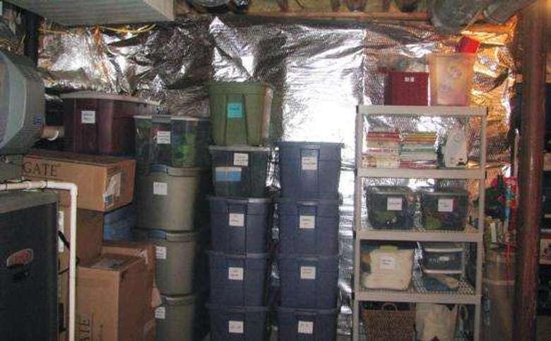 organized basement storage area with lots of plastic storage bins