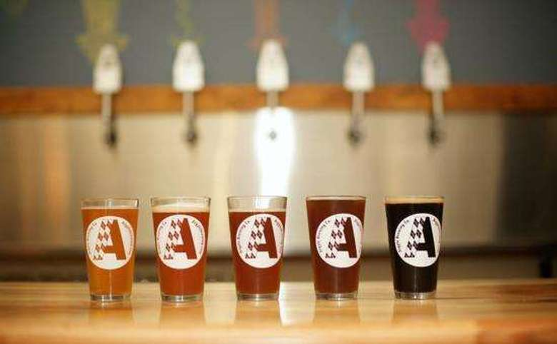 five pints of argyle brewing company beer in different colors