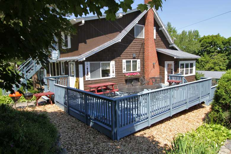 brown house with a blue deck