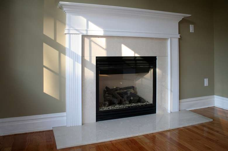 a white fireplace in a house