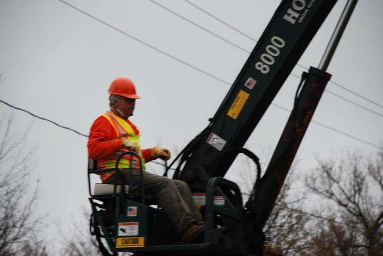 man operating a tree removal crane