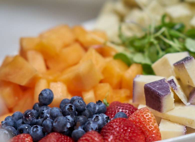 cubes of various cheeses plus strawberries and blueberries