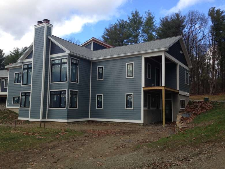 newly remodeled home with blue-gray siding