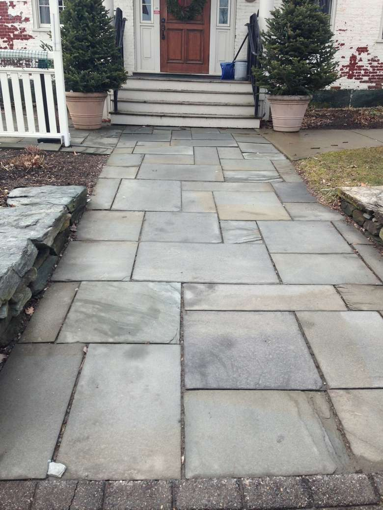 slate walkway leading up to a house's front porch