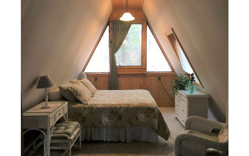a bedroom in an a-frame house