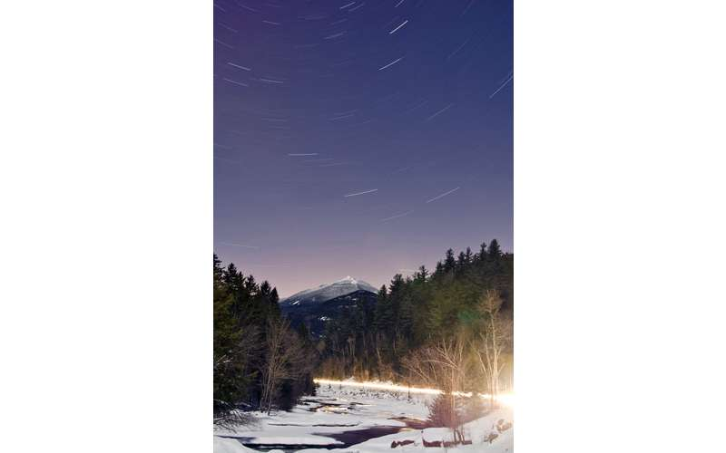 starry skies over a snowy mountain