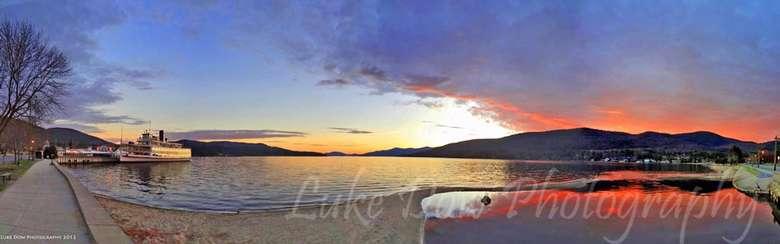 a panoramic shot of a lake's shoreline at dawn