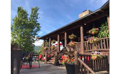 a sunny day at a rustic restaurant with a wooden patio