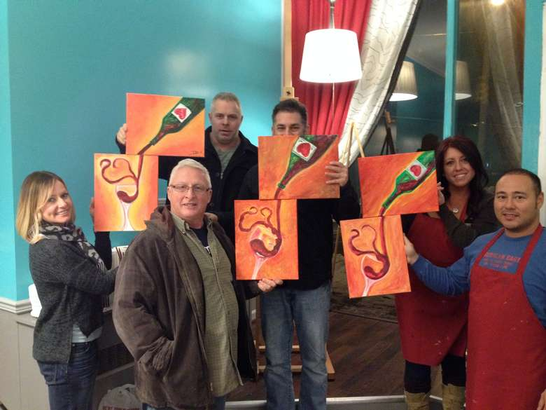 happy painters displaying their paintings