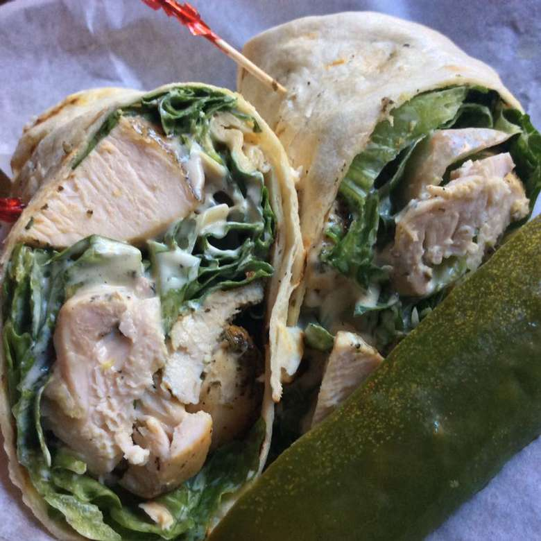a chicken Caesar wrap with a pickle