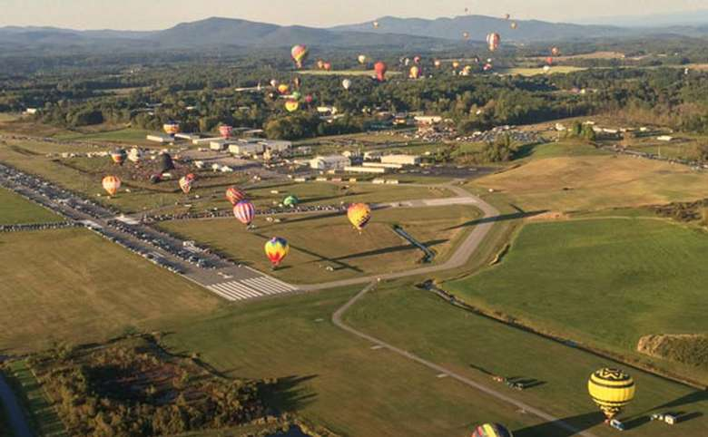 Aerial view of hot air balloons launching at the Adirondack Balloon Festival