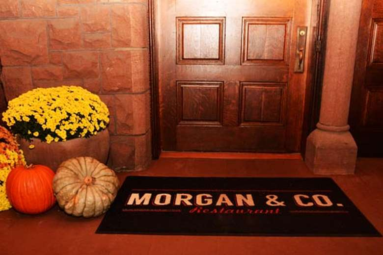door with flowers, pumpkins, and mat that says Morgan & Co.