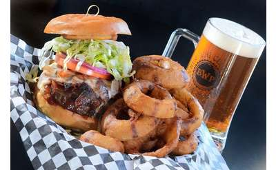 burger, onion rings, and beer