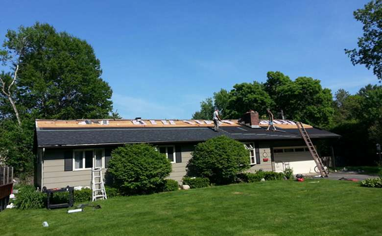 new roof being installed on a house