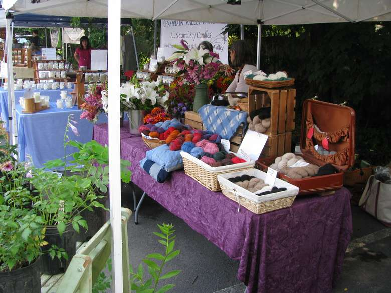 a vendor booth with yarns and wool