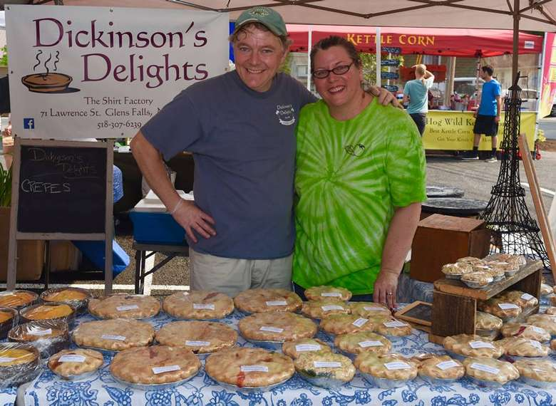 couple posing at Dickinson's Delights vendor booth