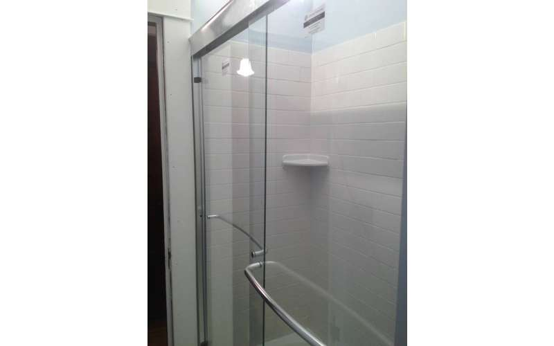 a shower with a glass door