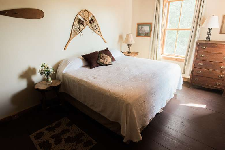 close up of bed with white covers