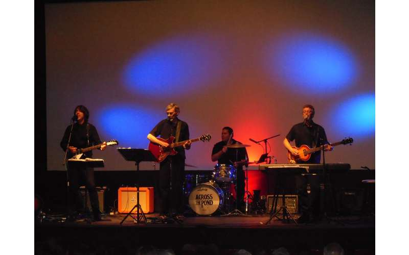 Beatles tribute band on stage