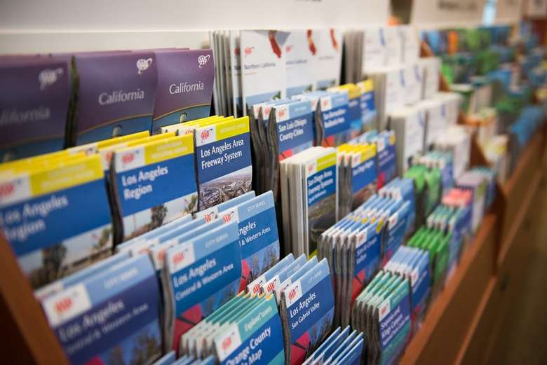A long row of road maps displayed in cases