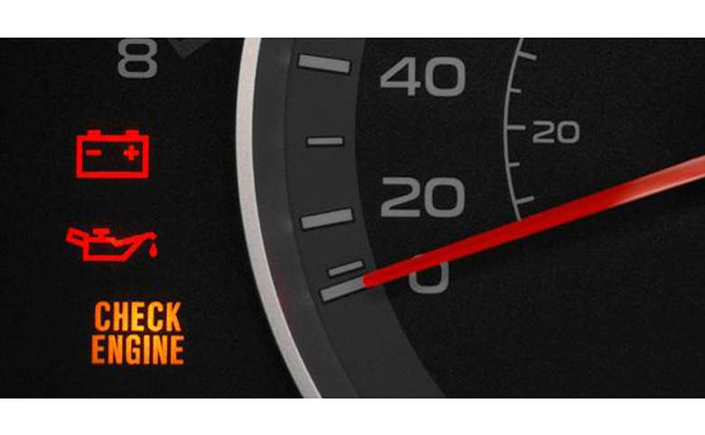 A dashboard of a car with the Check Engine light on