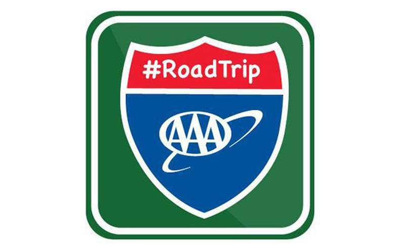 A green, red and blue decal that displays the triple A logo and the hashtag RoadTrip