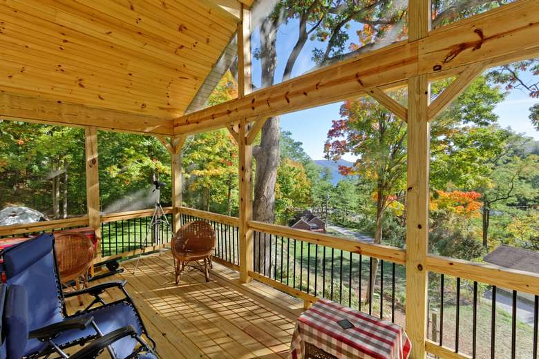 screened in porch on a log house