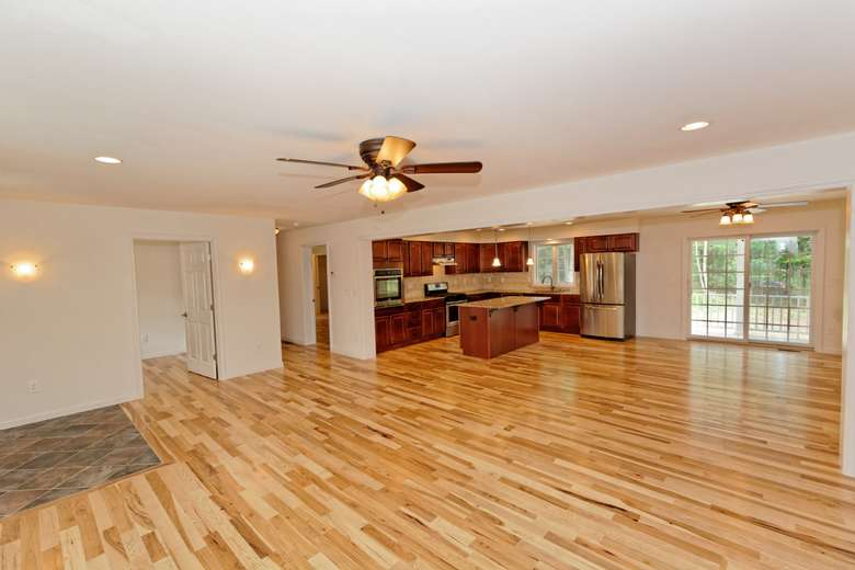 remodeled open-concept kitchen and living area with new hardwood floors