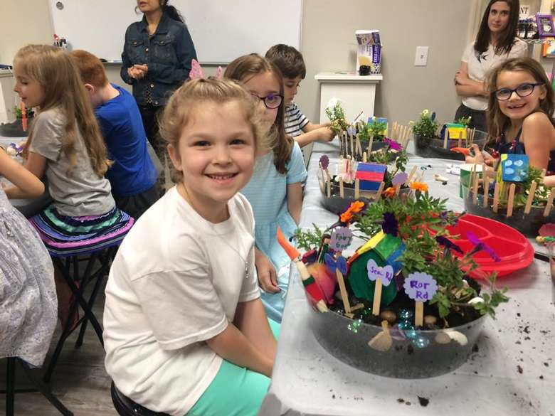 kids creating fairy gardens
