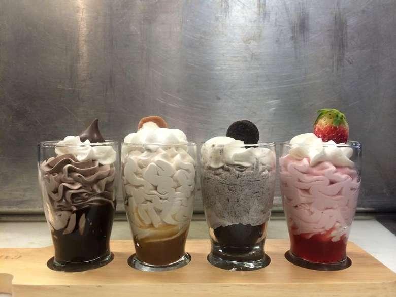 four desserts in glasses