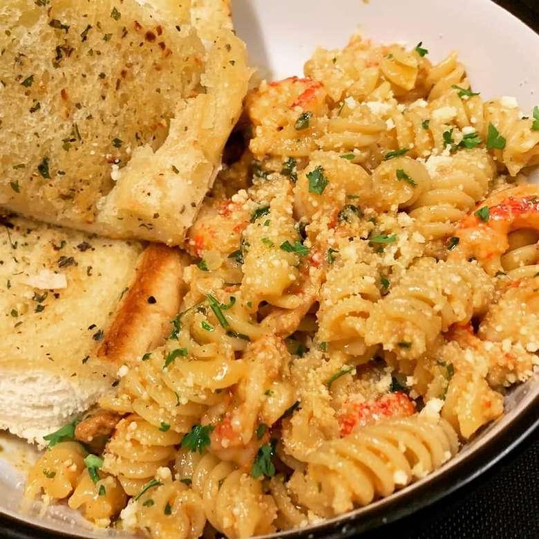 pasta dish with garlic bread