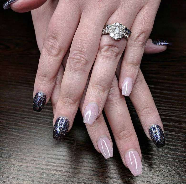 two hands with painted nails