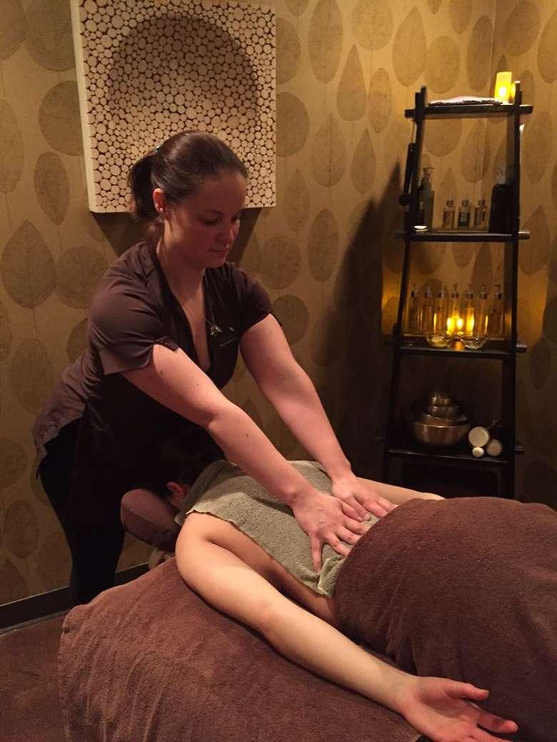 a woman receiving a back massage