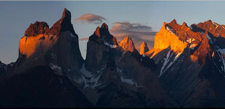 sun rising over jagged mountains