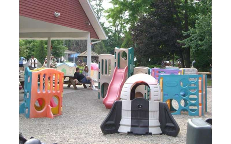 an outdoor playground for toddlers and young kids