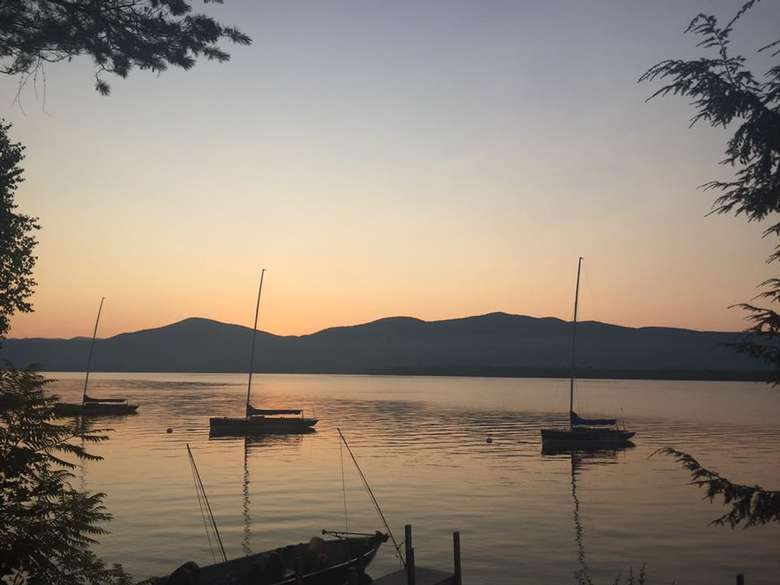 view of boats in water at sunset