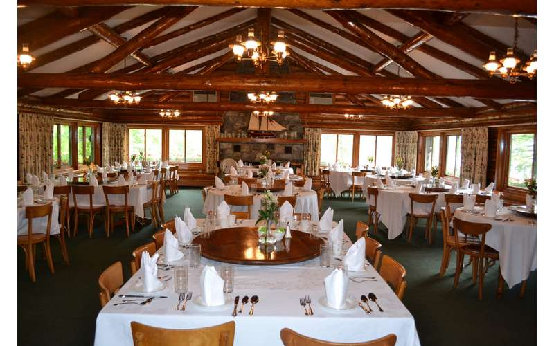 inside the lodge, tables set up for a wedding