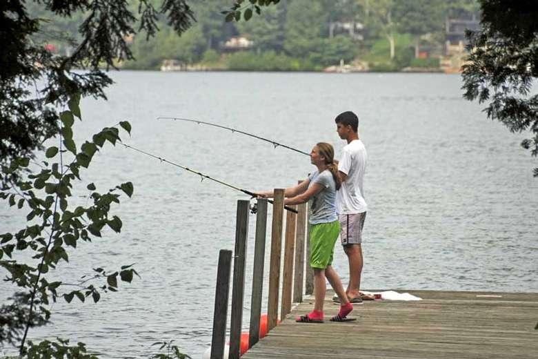 kids fishing off a dock