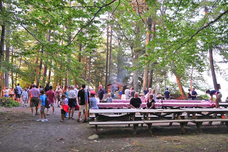 large group of people at picnic tables